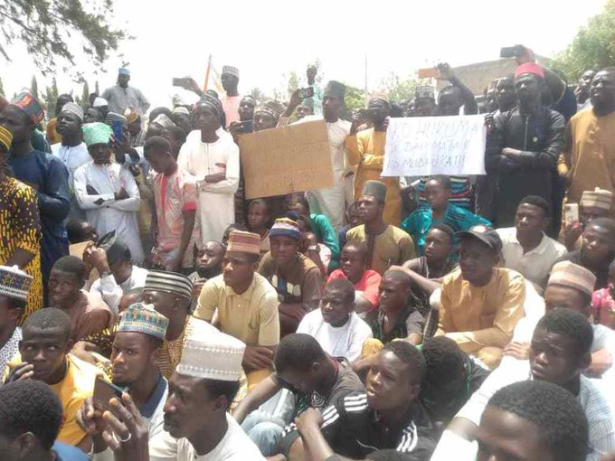 A picture of demonstrators holding placards at a protest calling for the prosecution Yahaya Sharif - a singer accused of blasphemy in a song. This is to reinforce the subject of the topic.